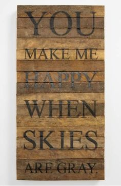 Weather-defying song lyrics are displayed across a rustic wall plaque crafted from 100-year-old tobacco-lath wood salvaged from farms in Wisconsin.