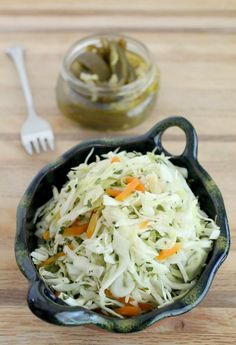 RECIPE: Spicy Cabbage Salad with Pickled Carrots. Tip: use jalapeños en escabeche from a can to make this easy version of spicy, vinegary cole slaw!