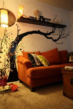 My tree mural over the sofa in our last apartment.   I like this idea. It's different but doable.