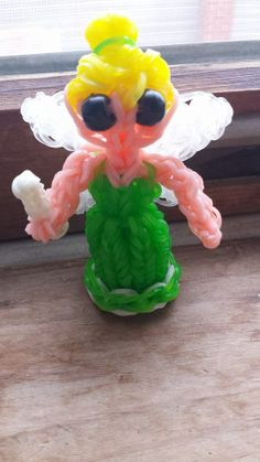 Rainbow Loom TINKERBELL inspired by the Kate Schultz stand up doll series (and MarloomZ Creations Fairy Wings?). Adapted and loomed by Sarah Hankey. ‎Rainbow Loom FB page. 05/29/14.