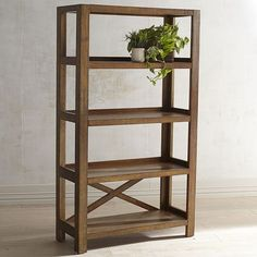 Our handcrafted hardwood shelf has all the qualities of the original created at the Parsons School almost 90 years ago: Balanced proportions, straightforward lines and flush, squared-off legs. But we're bold enough to add some all-new features, including an X-shaped support and a hand-distressed finish. Just our way of improving on history.