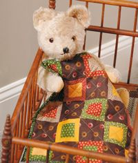 """All Around the Square -Quilt by Ann Hermes. Sometimes you just need to make something you can finish quickly. Ann Hermes is an expert at using her scraps of vintage fabrics to make small quilts. You can easily recreate this quilt using new reproduction fabrics. Note: This project is """"Fat Eighth Friendly.""""  Size: 12½"""" × 12½""""  Blocks: 13 (2½"""") blocks  FonsandPorter.com"""