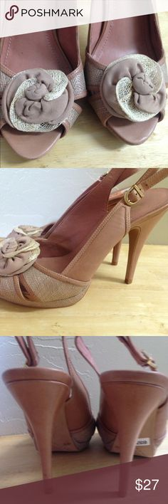 Vince Camuto heels Blush pink Vince Camuto slingback heels. They have a cute flower on the toe. They are open toe with a buckle slingback. They are a dogs pink leather. They are in great condition only worn a couple of times. Vince Camuto Shoes Heels