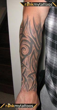 Tribal freehand half sleeve tattoo for men