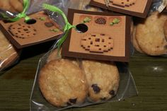 Minecraft Party Favors: Trader Joe's little oatmeal chocolate chip cookies look a little like Minecraft cookies.  Minecraft cookie image on card stock, holepunch, and ribbon.  One in each basic Creeper goodie bag.