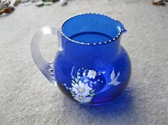 Check out this item in my Etsy shop https://www.etsy.com/listing/250684325/royal-blue-pairpoint-glass-hand-painted