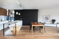 Black, white and wood kitchen via Heartly Interior Design Melbourne Cafe Interior, Kitchen Interior, Kitchen Design, Kitchen Decor, Kitchen Ideas, Timber Kitchen, Kitchen Flooring, Kitchen Furniture, Kitchen Island With Seating