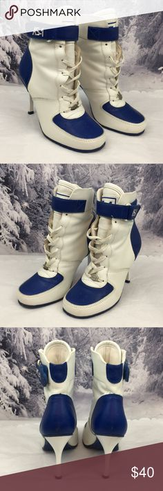 Women's sneaker heel boots Pre owned and hard to find Andrew Stevens AS-1 Sneaker boots size 7.  Please zoom in to check these shoes out. Andrew Stevens Shoes Athletic Shoes