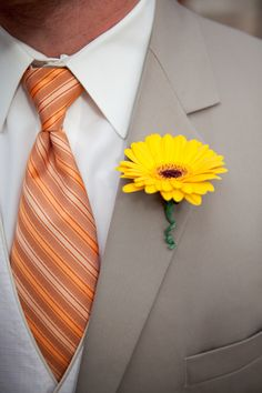 Love the idea of a sunflower boutonniere  - brings such life to the wedding!