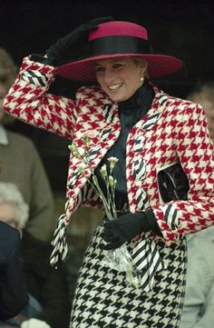 Princess Diana wears a large dog patterned red, white and black jacket and skirt at the christening of Princess Eugenie Victoria, the youngest daughter of the Duke and Duchess of York, at Sandringham Church Day in Sandringham, England on Dec. 23, 1990.