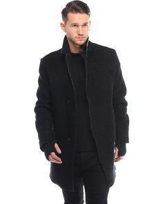 Transit Wollmantel Schwarz  cooler langer Mantel von Transit aus hochwertiger Wolle in Schwarz Zweiknopf-Leiste Kragen mit Lederelementen seitliche Einschubtaschen langes Leder-Patch an den Ärmeln gefüttert; Innentasche