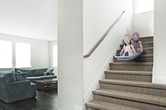 sisters gliding down stairs