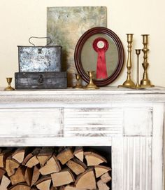 An old mantel from eBay lends the illusion of a fireplace in the master bedroom of this Washington home. The small brass candlesticks cost a quarter each at Goodwill; the tall ones, 99 cents. The homeowner snagged the tin boxes at the annual Farm Chicks Antique Show.