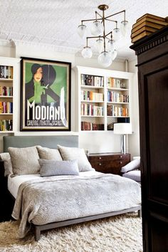 art, antique chandelier, bookcases around bed