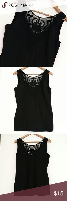"""H&M Black Lace Inset Tank Top Super sexy plunging double V Neck tank. Lace detail in the front with a deep V back as well. Black goes with everything! Dress up some jeans with heels for a night out or throw a blazer over it with a pencil skirt at the office. Longer length makes it great for layering with cardigans too! Gently loved. No pulls in the lace or fading.   {Measurements} Bust: 19"""" Length: 25""""  {Materials} Stretchy Cotton Blend!  95% Cotton 5% Elastane H&M Tops"""