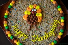Thanksgiving Cookie Cake- a giant chocolate chip and m cookie cake with buttercream frosting! #Thanksgiving #cookie www.shugarysweets.com