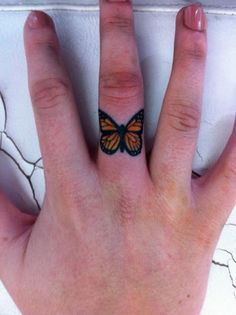 Tiny-Butterfly-Tattoo-Design-Ideas-On-Finger