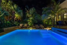 Landscape lighting to make the landscape stand out as dramatically as the gorgeous swimming pool