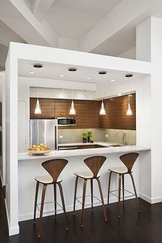 Smaller, open, wonderful kitchen with bar half wall- I'd do this to our apartment if we'd keep it!