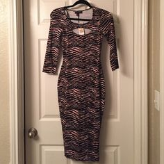 3/4 Sleeve Dress NWT 3:4 sleeve dress. Cutout in front (chest) and back (lower back). Mid-length. Size Small. Material Girl Dresses Midi