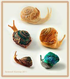 Beautiful snails sculpted by artist евгений хонтор. A better source: http://hontor.ru/photo/2-1-0-0-2 or http://www.livemaster.ru/hontor.