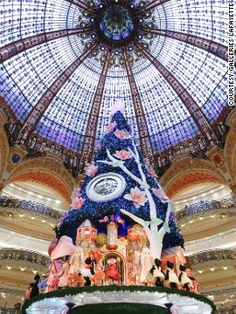 """Galeries Lafayette tree (France) The world's largest """"in-store"""" Christmas tree was designed by Swatch."""