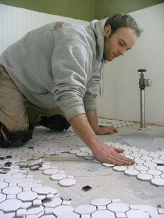 how to install a hex tile floor  http://www.ourfixerupper.com/installing-a-hex-tile-floor-part-1.htm