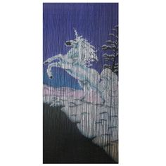 Unicorn is a 90 x beaded door curtain featuring a resplendent white unicorn in mid-gallop, the snow-covered landscape contrasting against a bright blue sky.