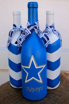 Dallas Cowboys wine bottles football decor by TheAnchoredElephant Empty Wine Bottles, Recycled Wine Bottles, Wine Bottle Art, Glass Bottle Crafts, Painted Wine Bottles, Beer Bottle, Dallas Cowboys Crafts, Wine Craft, Wine Decor