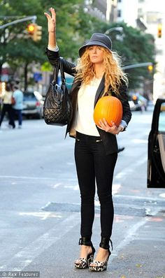 Blake Lively... style icon, with a nice pumpkin. Hat for fall