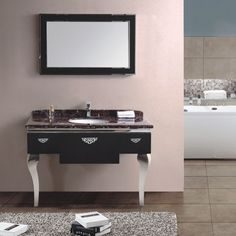 Give your bathroom an ultra sleek look with this Italian influenced luxury bathroom vanity set for one. Standing on long slender stainless steel legs, the single stunningly white ceramic basin sits atop our beautiful marble counter top. With a matching black trimmed mirror, this one of a kind set will give your bathroom the sleek look you've been wanting! Luxury Bathroom Vanities, Marble Countertops, Sleek Look, Counter Top, Vanity Set, Black Trim, Contemporary, Modern, Double Vanity