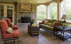 Screened porch with fireplace and arches