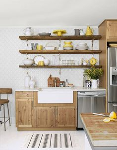 white, wood with yellow accents and of course and farmhouse sink