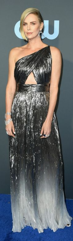 Who made Charlize Theron's silver one shoulder cut out dress, jewelry, and ankle strap sandals? Dress Sandals, Ankle Strap Sandals, Charlize Theron Style, Strapless Dress Formal, Formal Dresses, Fashion Dictionary, Shoulder Cut, Best Actress, Fashion Models