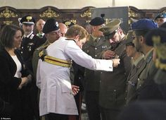 5/18/14.  Prince Harry meets Italian army officers inside Monte Cassino Abbey. The Battle of Monte Cassino was one of the most important campaigns of the Second World War