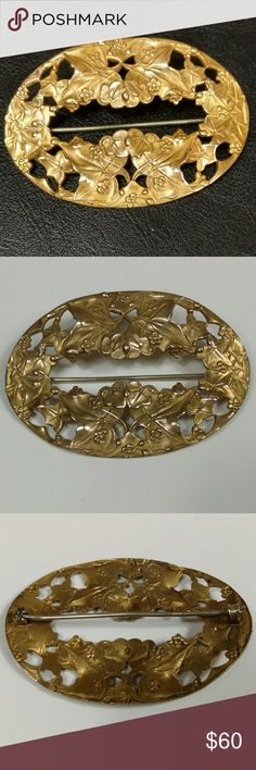 Vintage brass colored brooch floral and fauna This beautiful brooch has leaves and flowers in a great art nouveau design.  I am not sure of the date, but it has a c-clasp.  Absolutely lovely. Vintage Jewelry Brooches
