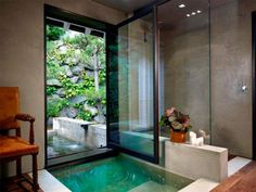 Concrete walls is very nice for this bathroom and frames the green outside beautifully.