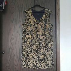 Lane Bryant sleeveless dress Knee length sleeveless dress with pockets! Tan and blaxk with black faux leather trim. Neckline has a notch in the front. Has a black fabric lining. Wore once for a wedding. Lane Bryant Dresses Midi