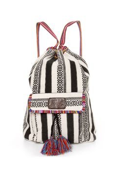 "Gear up for your next expedition with the Billabong Caravan Tribal Striped Backpack! Ivory woven bag has black tribal print stripes printed allover, with colorful Guatemala striped trim to add a pop of color to the opening, straps, and front flap pocket, which has a magnetic button closure and colorful tassels. Drawstring top tightens with shoulder straps. Leather logo tag on front flap. Adjustable shoulder straps. Backpack measures 16"" wide by 17"" tall and 5"" deep. 100% Cotton..."