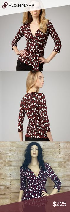 Diane von Furstenberg DVF Leopard Jill Wrap Top 12 Besotted with the bespotted—this maroon patterned Diane von Furstenberg wrap blouse, a twist on her iconic wrap dress, features an exuberant animal print and a self belt for a figure-forgiving fit. -Red/black/white spotted cat print silk jersey. -Wrap front creates deep surplice neckline. -Three-quarter sleeves. -Self tie belt cinches waist. -Silk; dry clean only. Diane von Furstenberg Tops Blouses