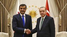 President Recep Tayyip Erdogan shakes hands with Sheikh Tamim bin Hamad Al Thani, the current Emir of Qatar