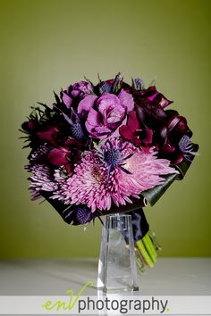 pretty purple/pink wedding bouquet with thistles!