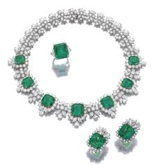 Impressive Emerald and diamond necklace and a pair of ear clips and a ring from the collection of Lily Marinho. photo Sotheby's.