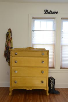 Vibrant mustard painted dresser. Love the knobs.