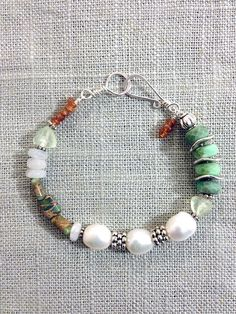 Green Turquoise, Pearl, Amber, Quartz & Green Amethyst Bracelet. Handcrafted with hand forged Sterling silver clasp and silver spacers. A favorite on Instagram!