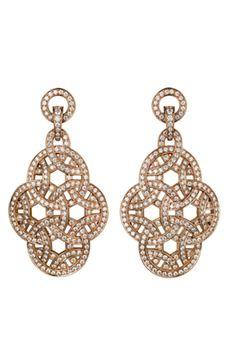 Pendientes de oro rosa y diamantes, de Cartier París Nouvelle Vague.