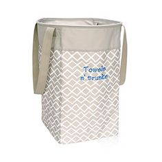 """Stand Tall Bin: Perfect for the dorm room or the playroom, this bin holds its shape to tote loads of laundry or piles of toys. Features a flexible frame around the top opening with interior sticks to add stability. Easily carry from place to place with two shoulder straps. Approx. 22""""H x 12.25""""L x 12.25""""D"""