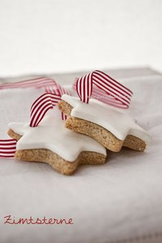 star shaped cookies with red and white ribbons