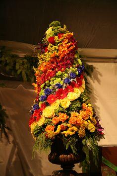 Colorful floral Christmas tree by Kebbie Hollingsworth Floral Design