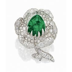 EMERALD AND DIAMOND 'FLOWER' BROOCH Designed as a single flower in full bloom, centring on a sugar loaf cabochon emerald weighing approximately 34.25 carats, surrounded by curling petals pavé-set with circular- and old mine-cut diamonds together weighing approximately 20.50 carats, mounted in platinum and 18 karat white gold.